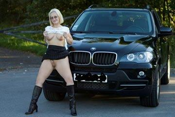 BMW-babe gets naked in public